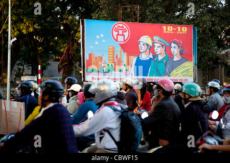 Propaganda sign and traffic in Hanoi, Vietnam, Asia - Stock Photo