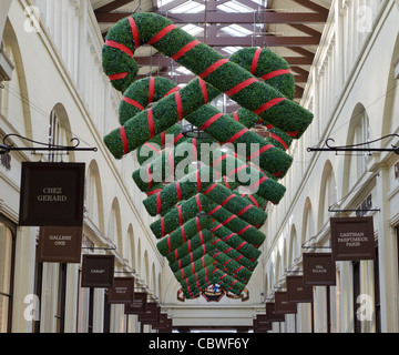 Christmas decoration hanging from roof inside Covent Garden market. London Uk - Stock Photo