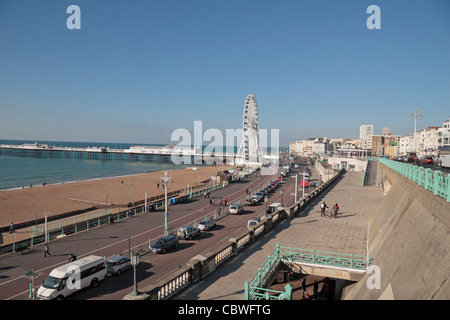 View towards Brighton's Palace Pier, along Madeira Drive on Brighton seafront, East Sussex, UK. - Stock Photo