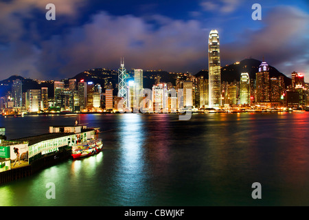 Hong Kong Harbor at Night from Kowloon Star Ferry Reflection - Stock Photo