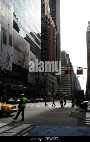 Sunny urban alley portrait, looking south, NYPD policemen directing traffic West 42nd Street 7th Avenue intersection, - Stock Photo