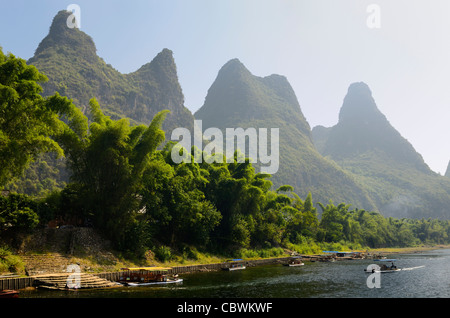 Steps to the Li river Guangxi Peoples Republic of China with fingerlike karst mountain peaks and bamboo forest - Stock Photo