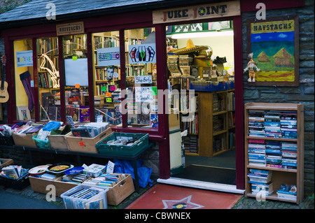 Miscellaneous secondhand books goods dvds and vinyl lps for sale outside shop in Hay-on-Wye Powys Wales UK - Stock Photo