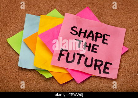 shape the future, motivational slogan, colorful sticky notes on cork bulletin board - Stock Photo