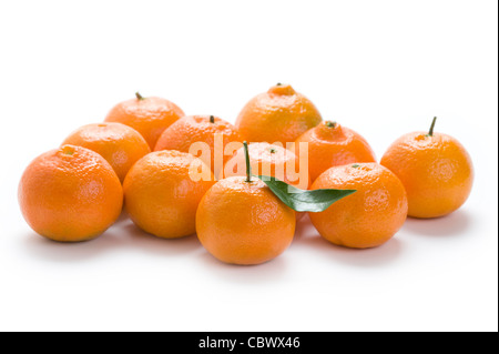 group of clementine oranges isolated on a white background - Stock Photo
