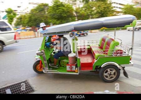 Thailand - Bangkok - Tuk-tuk - Green Colored auto rickshaw in street - motion blur - Stock Photo
