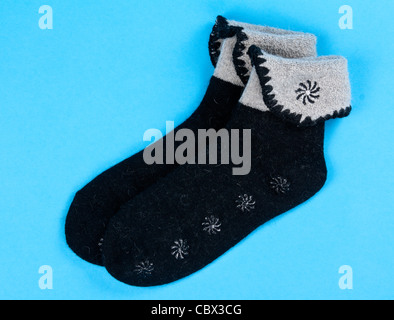 a pair of wool socks on a blue background - Stock Photo