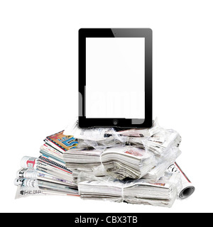 E-reader and newspapers isolated on white. - Stock Photo