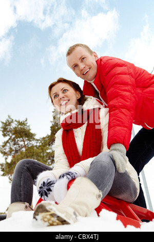 Portrait of happy couple having nice time during winter vacation - Stock Photo