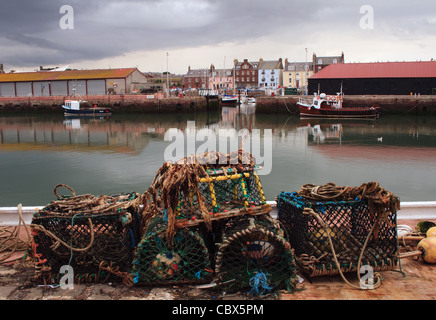 Lobster pots lying on pier at Arbroath - Stock Photo