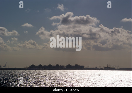 Gravelines nuclear power station seen in silhouette from the English Channel, Dunkerque, Dunkirk, France - Stock Photo