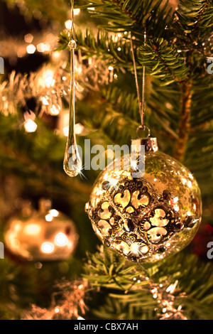 Christmas tree decoration in silver and glass with lights - vertical - Stock Photo