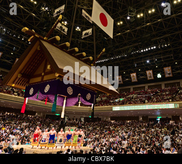Sumo wrestlers performing a ring entrance ceremony - Ryogoku Kokugikan, Tokyo, Japan - Stock Photo