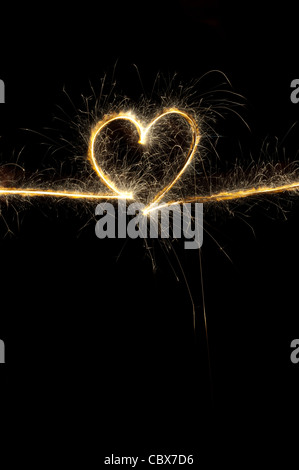 Heart shape made with sparkler at night.