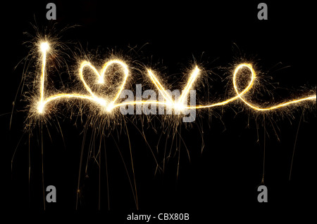 LOVE written with a sparkler at night including a heart shape