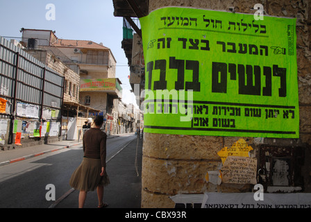 Signs in Hebrew, For Exclusion of Women in Mea Shearim neighborhood in Jerusalem, Israel. - Stock Photo