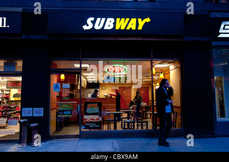 Fast food Subway restaurant in New York City at night - Stock Photo