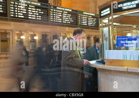Blurred people walking fast in Grand Central Terminal in Manhattan, New York City - Stock Photo