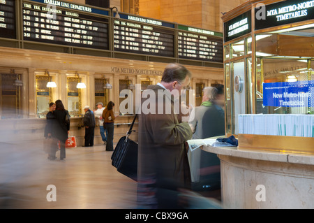 Blurred trails from people walking fast in Grand Central Terminal in Manhattan, New York City - Stock Photo