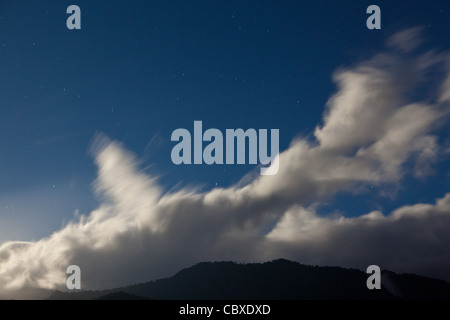 Moonlit clouds are drifting over Volcan Baru national park, Chiriqui province, Republic of Panama. - Stock Photo