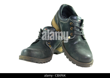 work boots, dirty shoes on isolated white background - Stock Photo