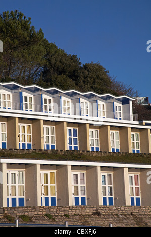 Beach huts at Branksome Dene Chine, Poole, Dorset on a sunny winter day in December - Stock Photo