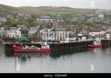Scotland, Orkney Islands, Mainland. Capital city of Stromness. Port area with downtown dock. - Stock Photo