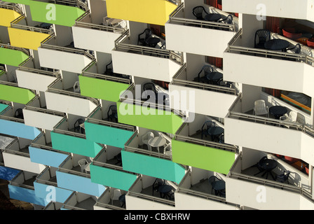 Colourful balconies on the facade of the Ostseebad Damp,the premium accommodation of the seaside/health resort at - Stock Photo