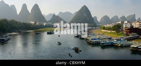 Panorama of Green Lotus Peak overlooking Yangshuo town harbor on the Li Jiang river China - Stock Photo