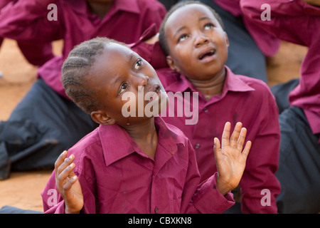 A children's church choir performs in Morogoro, Tanzania, East Africa. - Stock Photo