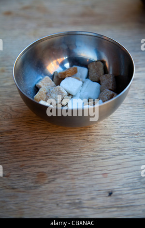Sugar Cubes in Bowl on Table - Stock Photo