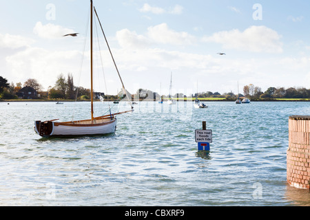 High tide floods the road in Bosham, West Sussex. Here King Canute (Cnut) is reputed to have told the tide to go - Stock Photo