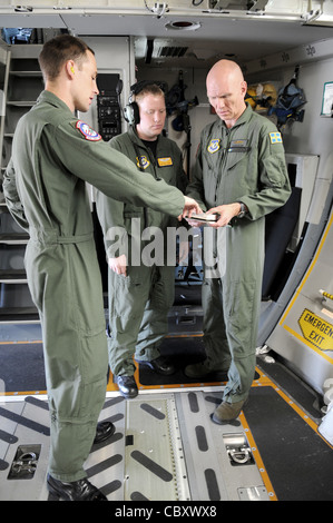 U.S. Air Force Tech. Sgt. Chris Copans (from left), Staff Sgt. Todd Perkins and Swedish 1st Lt. Harry Johansson, - Stock Photo
