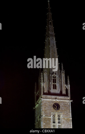 Church of England parish church of Saints Peter and Paul at night in Kings Sutton Oxfordshire England - Stock Photo