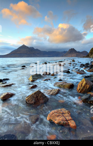 The Black Cuillin Hills on the Isle of Skye captured shortly before sunset from rocks near Elgol - Stock Photo