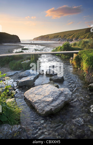 Porth/Polly Joke beach in Cornwall captured shortly before sunset - Stock Photo