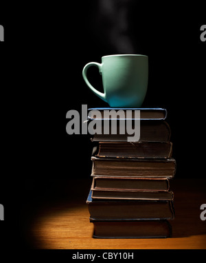 Coffee cup on Stack of books - Stock Photo
