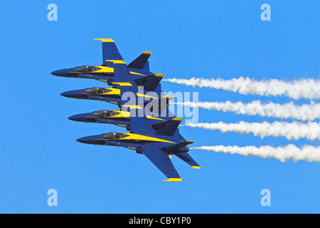 A close formation of Boeing F18 Hornet's of the US Navy's Blue Angels formation aerobatic team - Stock Photo