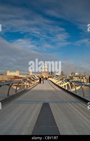 St Paul's Cathedral seen from the Millennium Bridge over the river Thames, London. - Stock Photo