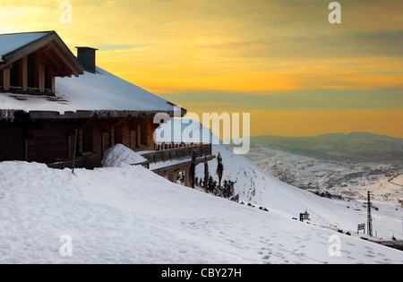 Sunset high up in the mountains, winter landscape - Stock Photo