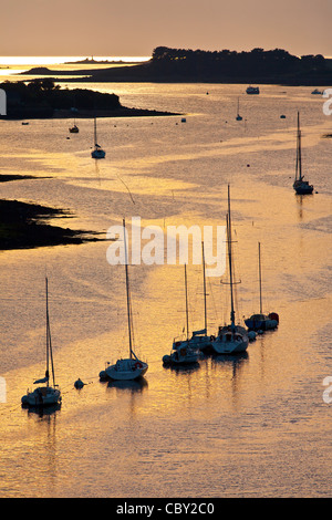 Sailboats in the Aber Wrac'h at sunset (Finistère - Brittany - France). - Stock Photo