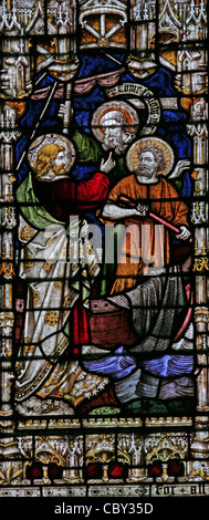 A stained glass window depicting scenes in the life of Jesus, St Peter & St Paul Church, Charing, Kent. - Stock Photo