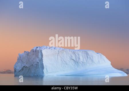 Iceberg at Sunset at Hall Bredning, Scoresbysund, Greenland - Stock Photo