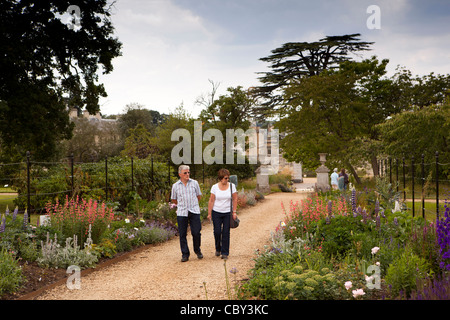 UK, England, Bedfordshire, Woburn Abbey Garden visitors walking on path through herbaceous borders - Stock Photo