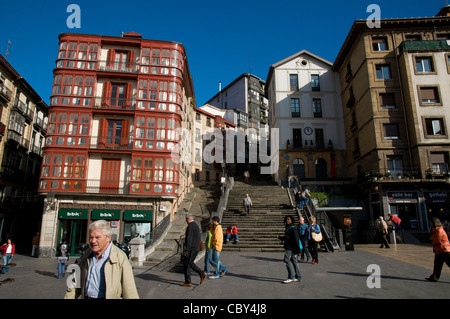 Red historical building in Miguel Unamuno Plaza, Casco Viejo, Bilbao, province of Biscay, Basque Country, Spain, - Stock Photo