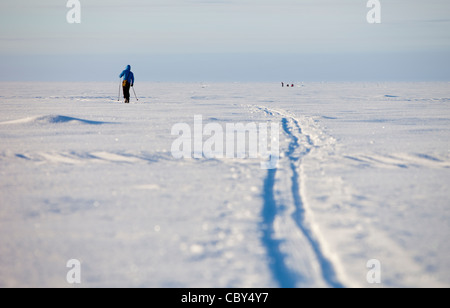 Cross-country skier on Baltic Sea ice , Finland - Stock Photo