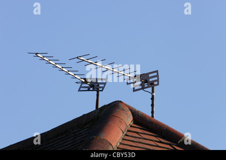 Television aerials on rooftop - Stock Photo