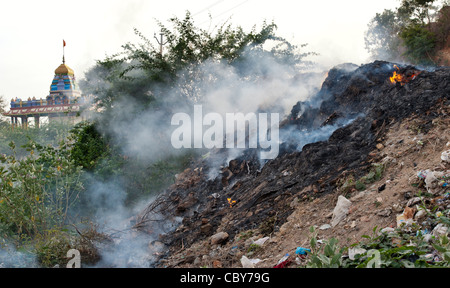 Household waste being burnt on the roadside in India. Andhra Pradesh, India - Stock Photo