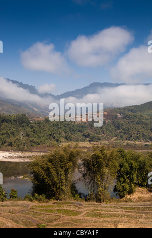 India, Arunachal Pradesh, Along, early morning cloud hanging over village beside Siang river - Stock Photo