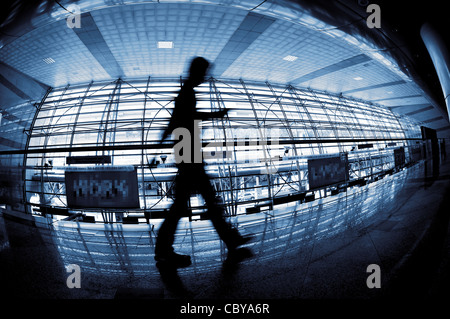 People silhouette walking through in modern building, in fish eye view. - Stock Photo